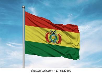 Bolivia national flag cloth fabric waving on beautiful sky.