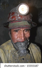 BOLIVIA - OCTOBER 15: A tired coal miner posing with coal dust on his face after a long day of work. Great Trekking adventure October 15, 2005 in Bolivia.