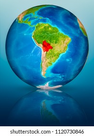 Bolivia in red on model of planet Earth on reflective blue surface. 3D illustration. Elements of this image furnished by NASA.