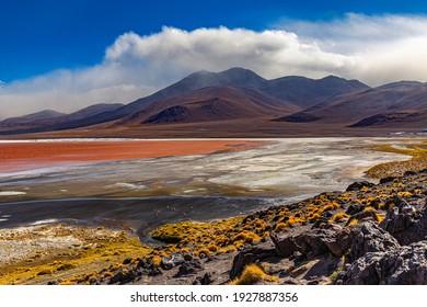 Bolivia, the southwest of the Altiplano. Eduardo Avaroa Andean Fauna National Reserve. Laguna Colorada (Red Lagoon), shallow salt lake with the reddish color of  water