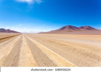 Bolivian dirt road perspective view,Bolivia. Salvador Dali Desert