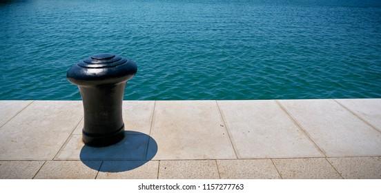 Bollard on the seaside promenade in the port of Pula in Croatia