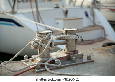 Bollard wound with rope, close-up in the port