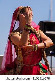 Bollywood dance performance outdoors, without faces
