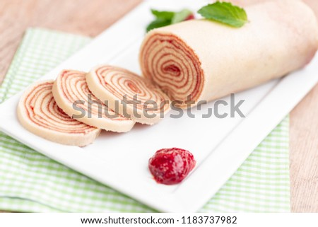 Bolo de rolo (swiss roll, roll cake) typical Brazilian dessert, from the state of Pernambuco. Sliced cake roll filled with Guava paste.