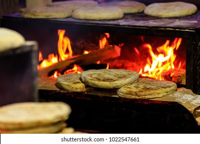 Bolo do caco is a flat, circular bread, shaped like a cake and thus called bolo (Portuguese for 'cake'). It is traditionally cooked on a caco, a flat basalt stone slab.