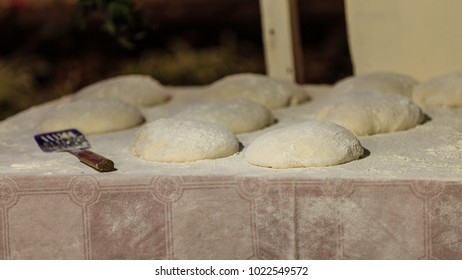 Bolo do caco is a flat, circular bread, shaped like a cake and thus called bolo (Portuguese for 'cake'). It is traditionally cooked on a caco, a flat basalt stone slab. Traditional raw bread.