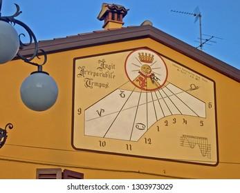 BOLOGNA, CASTEL SAN PIETRO – JANUARY 24, 2004: old wall clock. Very interesting clock design.