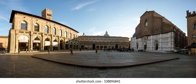 BOLOGNA, ITALY - 18 DECEMBER, 2016: A panoramic view of Bologna main square in a winter sunset. View of Piazza Maggiore and Palazzo del Podesta. Palazzo del Podesta was built around 1200.