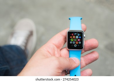 BOLOGNA, ITALY - APR 30, 2015: the Apple Watch. The first wrist device produced by Apple. Screen displays the weather and temperature
