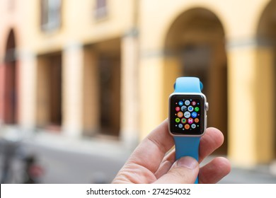 BOLOGNA, ITALY - APR 30, 2015: the Apple Watch. The first wrist device produced by Apple. Screen displays the application list.