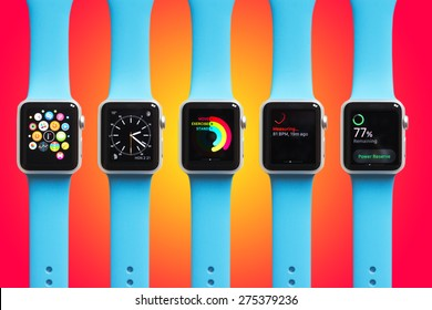 BOLOGNA, ITALY - APR 30, 2015: the Apple Watch. The first wrist device produced by Apple. Different screen samples displayed on gradient colorful background.