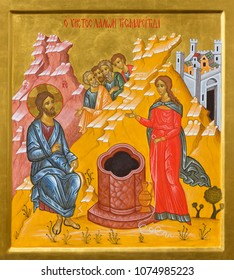 BOLOGNA, ITALY - APRIL 18, 2018:The icon of Jesus and Samaritans at well scene in church  Chiesa di San Pietro by Giancarlo Pellegrini.