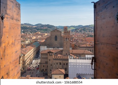 Bologna, Italy - April 2, 2018: Top view of bologna through the window of a tower.