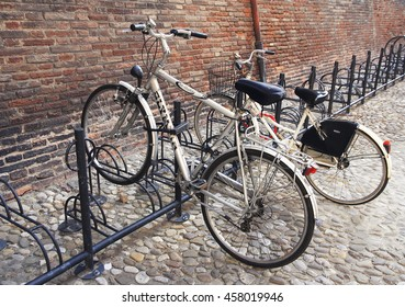 BOLOGNA, ITALY - APRIL 21, 2016: Bicycle parking on the background of the ancient city's architecture.
