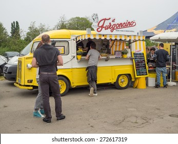 BOLOGNA, ITALY - April 25, 2015: The traditional Italian cuisine on the road. Food served by small trucks around the streets.