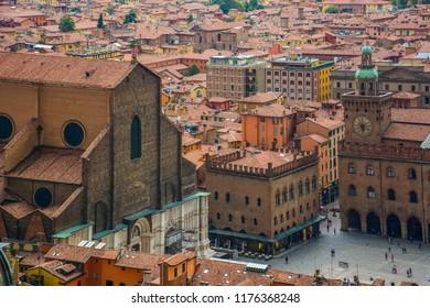 Bologna / Italy — August 19, 2014: aerial view of Piazza Maggiore, the central square of Bologna, Italy, from Torre degli Asinelli with Palazzo d'Accursio (Comunale) and Basilica of San Petronio