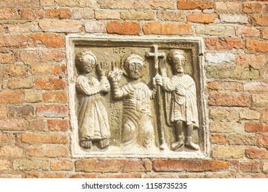 Bologna, Italy - August 2 2018: Stone carving of Saints Vitale and Agricola on the exterior of the basilica of Santo Stefano