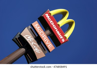 BOLOGNA, ITALY - AUGUST 24 2016 - Editorial: the mcdonalds advertising sign above a pylon in the blue sky