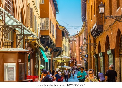 BOLOGNA, ITALY - AUGUST 27, 2016:  tourists and locals go shopping in  medieval market. The trade vocation of this area known as Quadrilatero, meaning The Quadrilateral Area, was born in Middle Ages