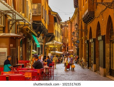 BOLOGNA, ITALY - AUGUST 27, 2016:  tourists and locals go shopping in medieval market. The trade vocation of this area known as Quadrilatero, meaning The Quadrilateral Area, was born in Middle Age