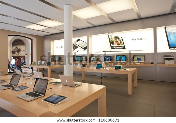 BOLOGNA, ITALY - AUGUST 6: People visiting the Apple Store on August 6, 2012 in Bologna, Italy. Apple has 363 stores worldwide, with global sales of US$16 billion in merchandise in 2011.