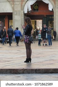 BOLOGNA, ITALY - CIRCA APRIL 2018: unidentified stylish woman with mobile phone