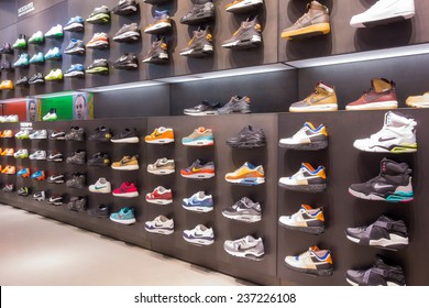 Bologna, ITALY - Dec 11, 2014: A view of a wall of shoes inside the local Nike shop