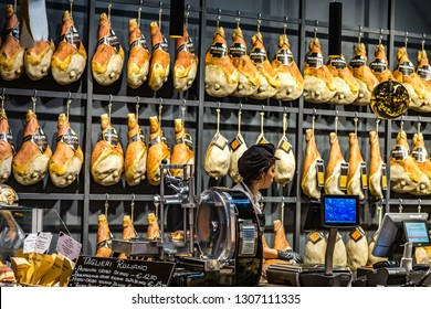 BOLOGNA, ITALY - DECEMBER 16, 2018:  clerk waiting for customers at TAGLIERI RULIANO ham shop at FICO Eataly World, the largest gourmet agri-food park in the world