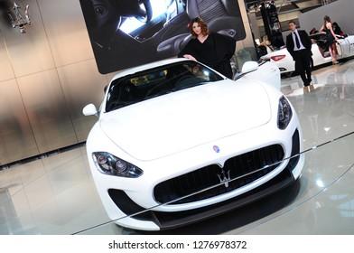 BOLOGNA, ITALY - DECEMBER 2, 2010: beautiful fashion model poses at Maserati Stand at the Bologna Motor Show. Italy