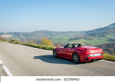 BOLOGNA, ITALY - DECEMBER 8, 2013: Ferrari California Sports car on the hills of Bologna. The Ferrari California is a grand touring 2+2 sports car produced by the Italian manufacturer Ferrari.