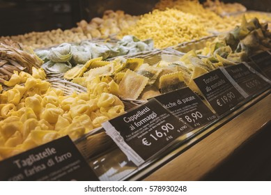 BOLOGNA, ITALY - FEBRUARY 08, 2017. Food court selling fresh pasta by weight.