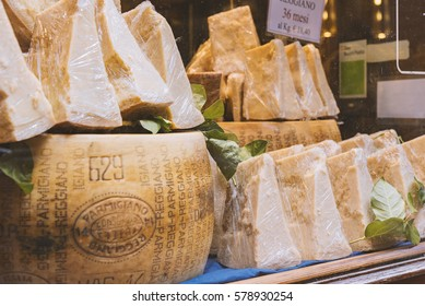 BOLOGNA, ITALY - FEBRUARY 08, 2017. Shop window display of local cheese shop selling Parmigiano Reggiano.