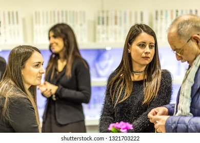BOLOGNA, ITALY - FEBRUARY 18, 2019: booth presenters talking with visitor at stand of MARIAROSARIA SAVARESE in DEVOTIO Religious products and service exhibition