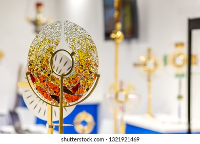 BOLOGNA, ITALY - FEBRUARY 18, 2019: lights are enlightening monstrances at stand of ELLECI, in DEVOTIO Religious products and service exhibition