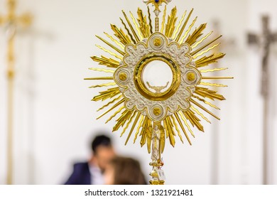 BOLOGNA, ITALY - FEBRUARY 18, 2019: lights are enlightening monstrances at stand of MOLLICA-SGA SNC, in DEVOTIO Religious products and service exhibition