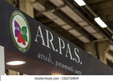 BOLOGNA, ITALY - FEBRUARY 18, 2019: lights are enlightening ARPAS logo on signboard on stand in DEVOTIO Religious products and service exhibition