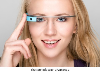 Bologna, ITALY - Jan 31, 2016: A woman wearing Google Glass. Google Glass is a wearable computer with an optical head-mounted display google decides to discontinue this year.
