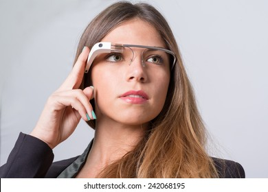 Bologna, ITALY - Jan 4, 2015: A woman wearing Google Glass. Google Glass is a wearable computer with an optical head-mounted display that is being developed by Google