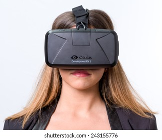 Bologna, ITALY - Jan 4, 2015: A woman wearing Oculus Rift. Rift is a wearable computer with an optical head-mounted display that is being developed by Oculus