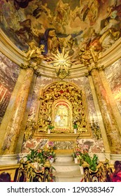 Bologna, Italy - January 12, 2018: altar with Madonna with child icon, popular devotion of faithful and pilgrims. Interior Madonna of San Luca sanctuary, a basilica dedicated to Marian Catholic cult.
