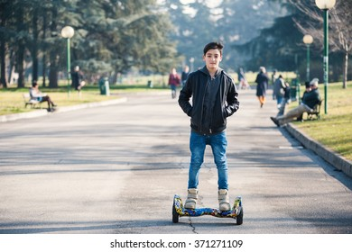 BOLOGNA, ITALY -  JANUARY 31, 2016: Teenager on Hoverboard, a rechargeable battery-powered scooter. It consists of two wheels arranged side-by-side, with two small platforms between the wheels.