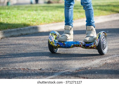 BOLOGNA, ITALY -  JANUARY 31, 2016: Close up of Hoverboard, a rechargeable battery-powered scooter. It consists of two wheels arranged side-by-side, with two small platforms between the wheels.