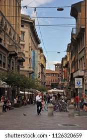 BOLOGNA, ITALY – JULY 15, 2017:  locals and tourists relaxing in Orefici street. This is a medieval part of the town.