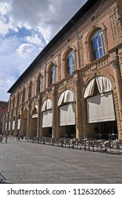 BOLOGNA, ITALY – JULY 15, 2017:  locals and tourists in Maggiore square in front of the King Enzo palace. This is a medieval part of the town.