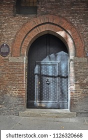 BOLOGNA, ITALY – JULY 15, 2017:  medieval Caccianemici house front door. The house built in 13 century.