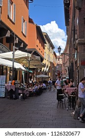 BOLOGNA, ITALY – JULY 15, 2017:  locals and tourists relaxing in Clavature street. This is a medieval part of the town.