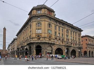 BOLOGNA, ITALY – JULY 15, 2017:  local and tourists in Rizzoli street with the Asinelli tower in the bottom. One of the city typical street.
