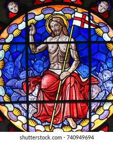 BOLOGNA, ITALY - JULY 15, 2017: Stained Glass in the Basilica of San Petronio, Bologna, Emilia Romagna, Italy, depicting Jesus Christ in Heaven