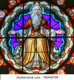 BOLOGNA, ITALY - JULY 15, 2017: Stained Glass in the Basilica of San Petronio, Bologna, Emilia Romagna, Italy, depicting God the Father in Heaven
